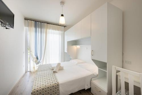 Postel nebo postele na pokoji v ubytování Hotel Tizian Beach