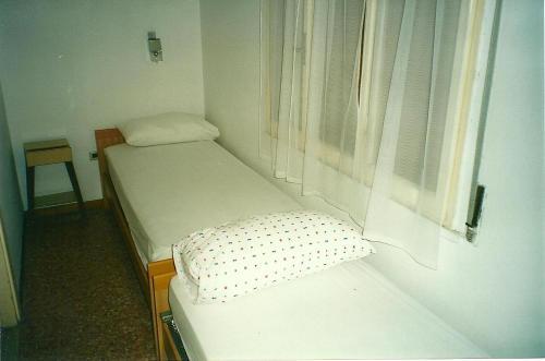 Letto o letti in una camera di village CAMPO DEL SOLE