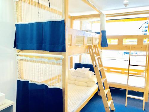 A bunk bed or bunk beds in a room at Very Hostel Namba