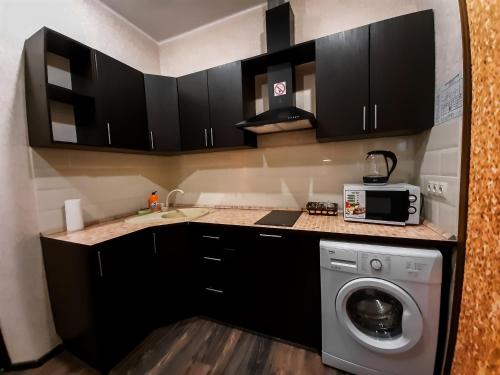 A kitchen or kitchenette at Apart-hotel