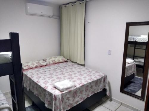 Cama ou camas em um quarto em Dunas Hostel