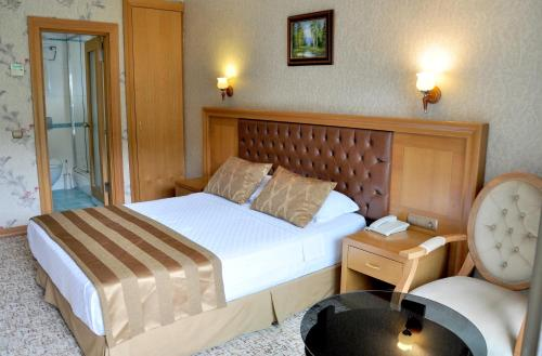 A bed or beds in a room at Örsmaris Boutique Hotel