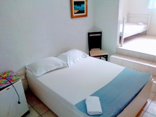 A bed or beds in a room at Asa Branca Residence