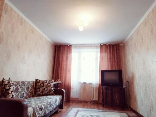 Гостиная зона в One Bedroom Apartment on Shostakovich