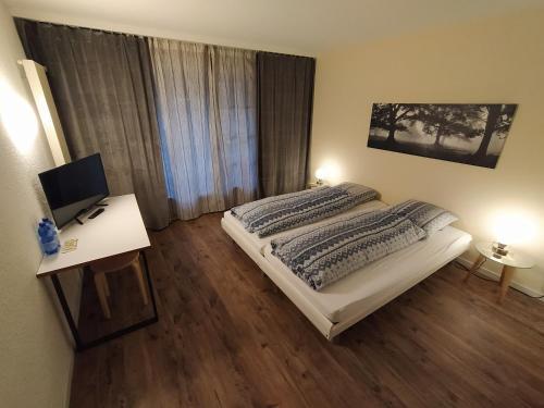 Ein Bett oder Betten in einem Zimmer der Unterkunft Motelina