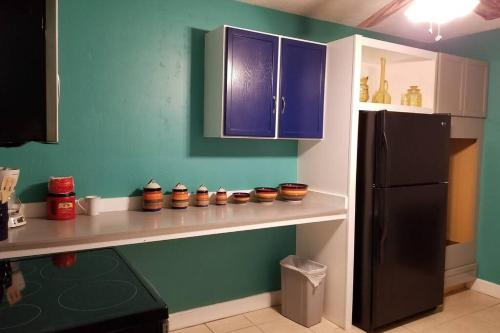 A kitchen or kitchenette at Artists' Retreat