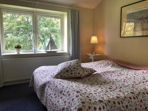 A bed or beds in a room at B&B Tiendegaarden Møn