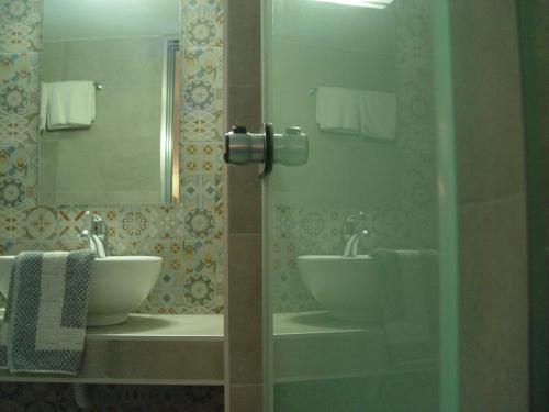 A bathroom at Helena Hotel