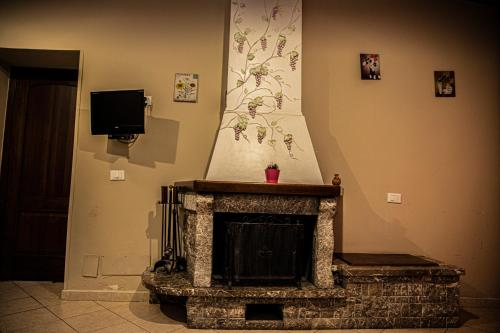 Casa Vacanze Etna tesisinde bir televizyon ve/veya eğlence merkezi