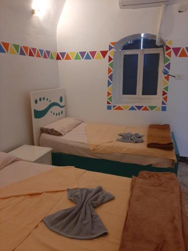 Ein Bett oder Betten in einem Zimmer der Unterkunft Baba Dool