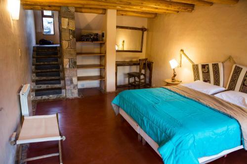 Una cama o camas en una habitación de Alas del Alma