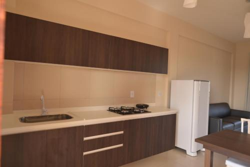 A kitchen or kitchenette at Cumbuco Residence