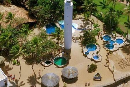 A view of the pool at Belissímo Vista Mar na Praia do Forte or nearby