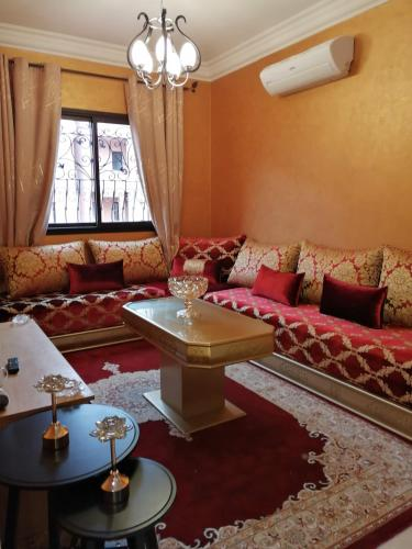 A seating area at Stylish Two Bedroom Apartment With Full Amenities - Free Wifi-Netflix-IPTV