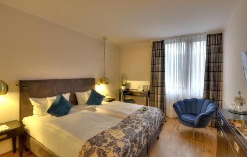 A bed or beds in a room at Nells Park Hotel