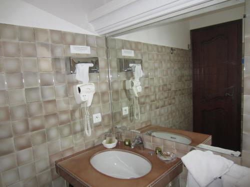 Salle de bains dans l'établissement Hotel Belle Vue