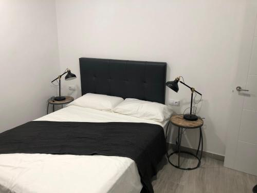 A bed or beds in a room at Brazan Holidays