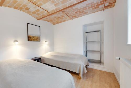 A bed or beds in a room at Adventure Park Apartments
