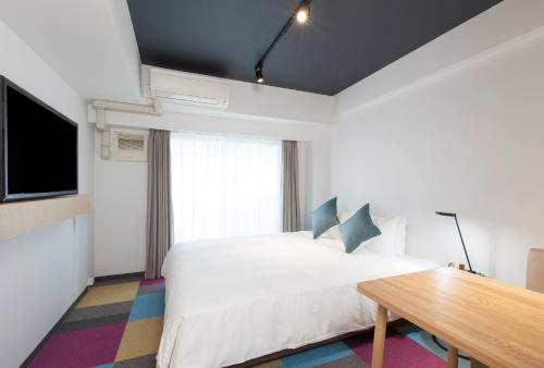 A bed or beds in a room at Tokyu Stay Meguro Yutenji