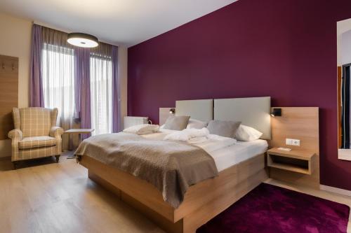 Ein Bett oder Betten in einem Zimmer der Unterkunft Das Steinberger