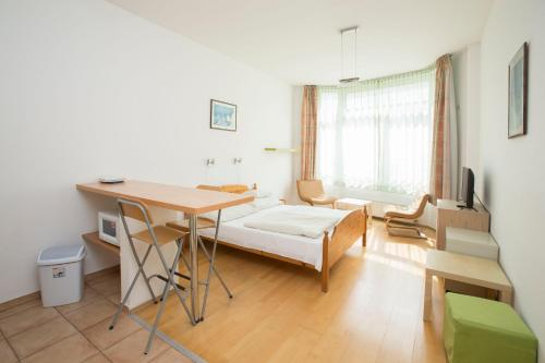 A bed or beds in a room at Astra Apartments