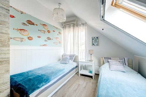Łóżko lub łóżka w pokoju w obiekcie Villa Pastelowa