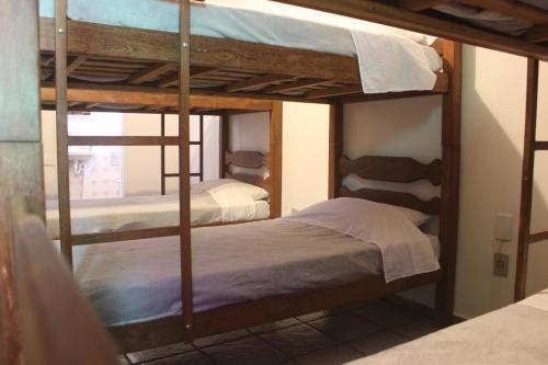 A bunk bed or bunk beds in a room at Casa Monjardim