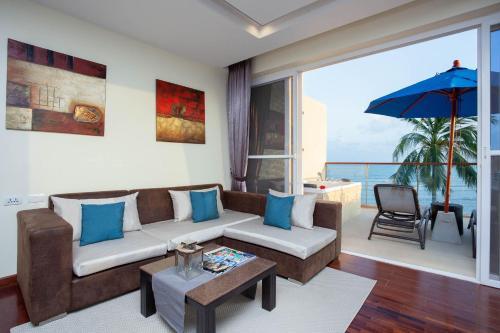 A seating area at Royal Beach Boutique Resort & Spa Koh Samui