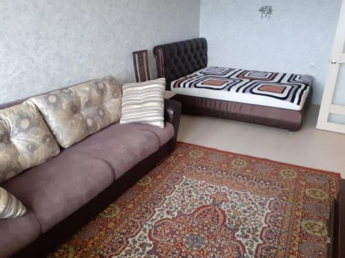 A bed or beds in a room at Квартира ЖК Солнечный