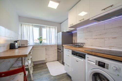 Kuchnia lub aneks kuchenny w obiekcie Corka Rybaka Apartments