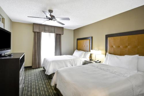 A bed or beds in a room at Homewood Suites Durham-Chapel Hill I-40