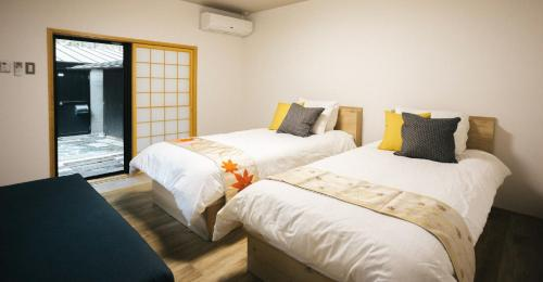 A bed or beds in a room at Miyajima Shiro
