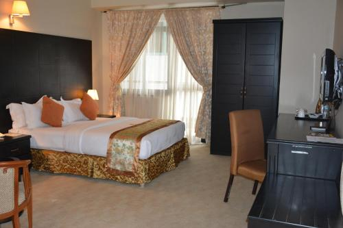 A bed or beds in a room at Gold Crest Hotel