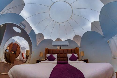 A bed or beds in a room at Petra Bubble Luxotel
