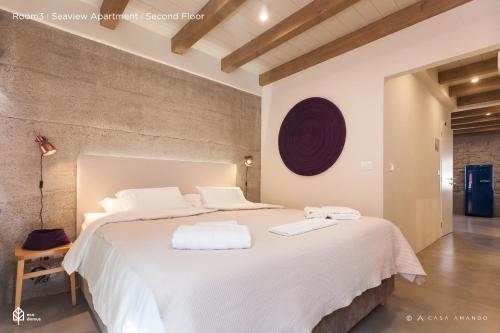 A bed or beds in a room at Casa Amando Boutique Guesthouse