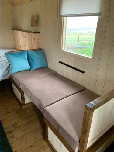 A bed or beds in a room at Glamping at Holly Grove Farm