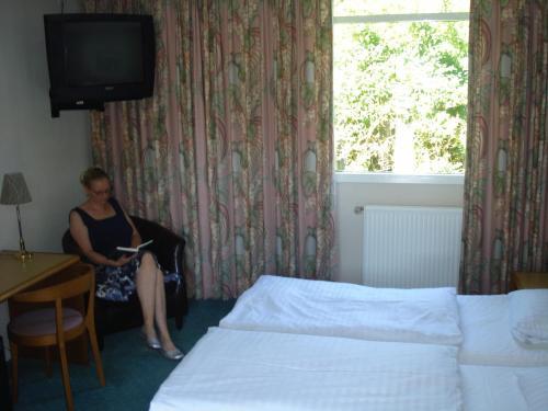 En eller flere senge i et værelse på St. Binderup Kro