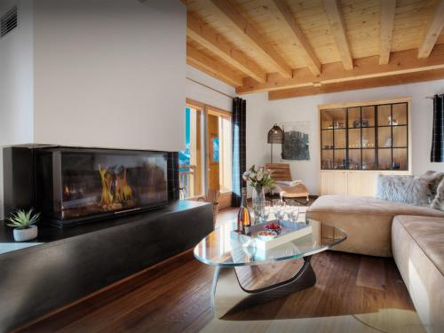 A television and/or entertainment center at Chalet Manoe - OVO Network