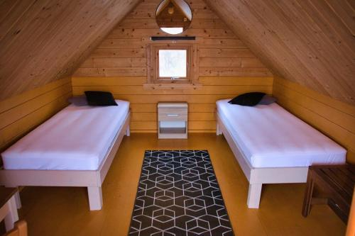 A bed or beds in a room at Fossatun Camping Pods & Cottages - Sleeping Bag Accommodation