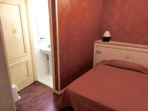 Cama ou camas em um quarto em Hotel Conterie