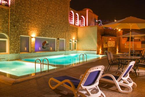 The swimming pool at or near Pioneer Hotel Apartments Muscat