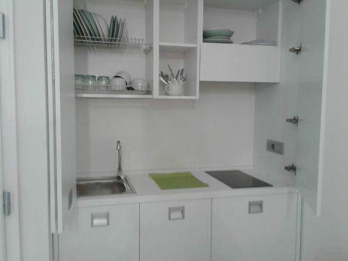 A kitchen or kitchenette at LOFT 13