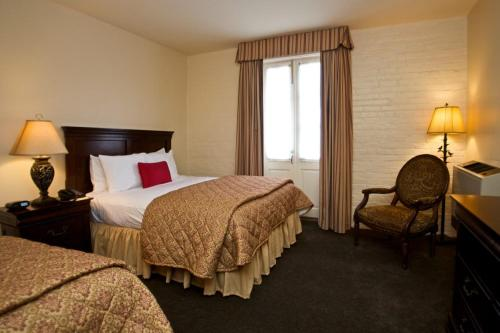 A bed or beds in a room at Le Richelieu in the French Quarter