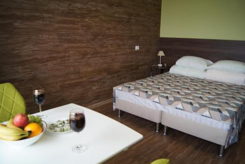 A bed or beds in a room at Larus hotel