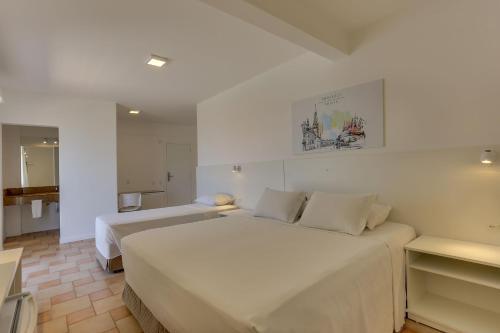 Cama ou camas em um quarto em Express Floripa Residence