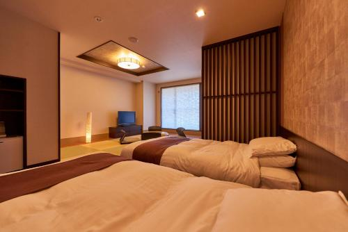A bed or beds in a room at Niseko Prince Hotel Hirafutei