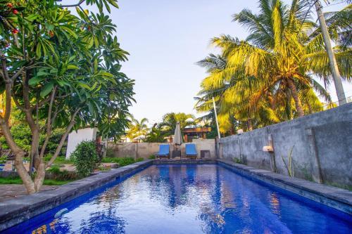 The swimming pool at or close to Balengku Homestay