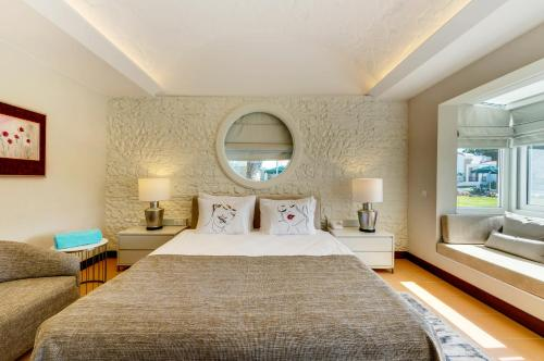 A bed or beds in a room at Robinson Club Nobilis - All inclusive