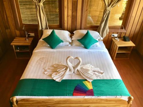 A bed or beds in a room at Inle Cottage Boutique Hotel