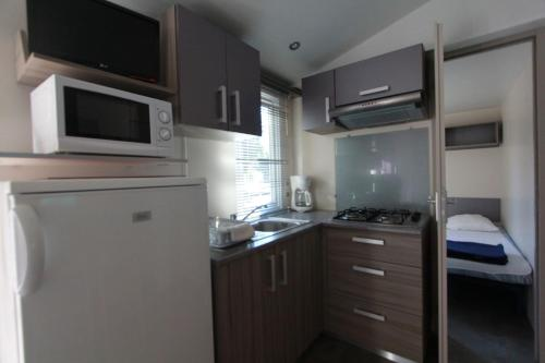 A kitchen or kitchenette at Camping Dolce Vita